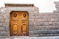 inca stonework and wooden door - stock photo