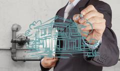 businessman hand presents house model on modern computer - stock illustration