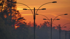 4K. Amazing sunset above highway lights (lanterns) Stock Footage