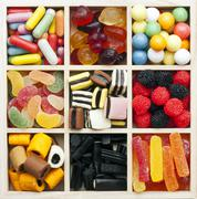 Assorted sweets in a square box Stock Photos