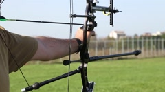 Aiming with bow and arrow - stock footage