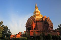 sandstone pagoda temple touching sunlight in korat - stock photo