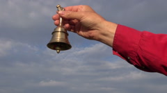Beautiful brass bell sound in hands and sky Stock Footage