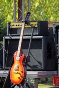 Electric guitar and amplifier on stage Stock Photos