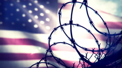 American flag waving behind a barbed wire fence. Seamless loop. - stock footage