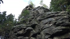 4k Big rocks monument closeup tilt down in low mountain range Harz Stock Footage