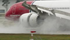 Boeing 787 Dreamliner Norwegian breaking thrust at runway Stock Footage