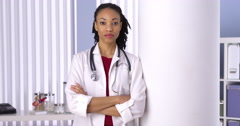 Successful black woman doctor standing in office Stock Footage