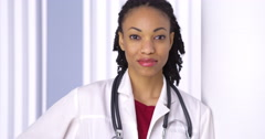 Black woman doctor smiling at camera Stock Footage