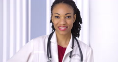African woman doctor smiling at camera Stock Footage