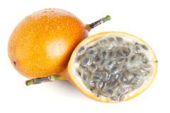 Whole and half grenadilla passion fruit isolated Stock Photos