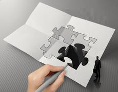 Hand drawing partnership puzzle and businessman icon on crumpled paper as con Stock Illustration