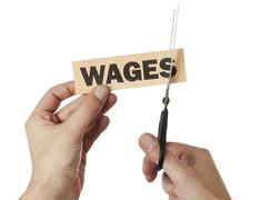 cutting down wages - stock photo