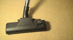 Vacuum Cleaner On A Bamboo Carpet, Cleaning, House, Chore, Top Down View, Follow - stock footage