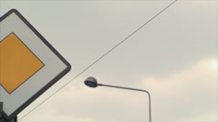 Priority Street Sign, Pole, Sky, Power Lines, Pan Shot Stock Footage