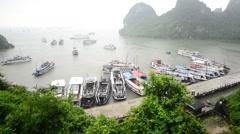 Tourist Boats Dock at Island Bay  - Ha Long Bay Vietnam Stock Footage