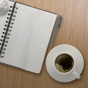 3d cup of coffee in a white cup and blank note book on wooden background as c Stock Illustration
