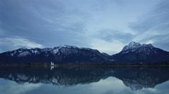 Bavarian Alps and lake at dusk Stock Footage