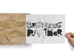 hand pulling crumpled paper from envelope with design word business partner a - stock illustration