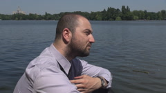 Very tired businessman outdoor, bad day at work stressful job, frowned man view - stock footage