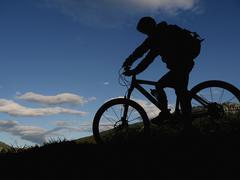 silhouette mountain biker - stock photo