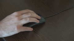 Closeup hand using mouse for computer, scrolling and clicking buttons move mouse Stock Footage