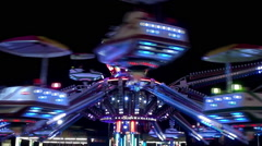 Amusement ride at night. - stock footage