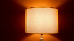 Table lamp  light on brown wall background Stock Footage
