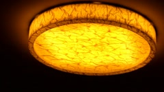 Ceiling lamp in gold tones in a modern hotel Stock Footage
