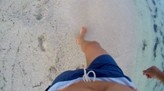 Lost man walking on sand with  footsteps in sand, pov from above Stock Footage
