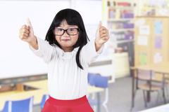 adorable girl in kindergarten class - stock photo