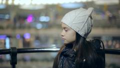 Female child rides in the lift going down. Model Elizabeth Andreeva. Stock Footage