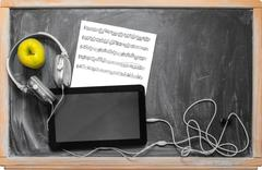tablet  and headphones. - stock photo