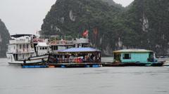 Floating Fishing Village from Boats POV - Ha Long Bay Vietnam Stock Footage