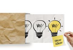 Stock Illustration of hand pull crumpled paper show light bulb out of recycle envelope as concept