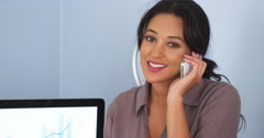 Mexican American business woman talking on cellphone and smiling Stock Footage