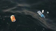Juice Box and garbage plastics floating in the sea Stock Footage