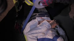 Stock Video Footage of Paramedics immobilizing victim