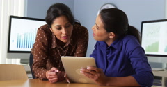 African American business women working on tablet computer with hispanic - stock footage