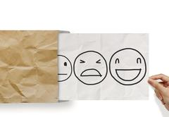 Hand pull crumpled paper with customer service evaluation icon as concept Stock Illustration