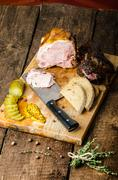 slowly smoked meat and pickles - stock photo