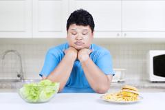 person doubt to choose foods - stock photo