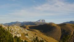 Panoramic view of Campo Imperatore land with Gran Sasso mountain in the distance - stock footage