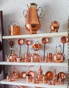 Copper utensils in souvenir shop Stock Photos