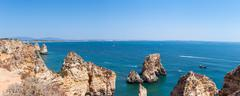 panoramic view of rock formation near lagos in portugal - stock photo