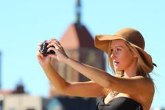 stylish traveler woman with camera old town gdansk - stock photo