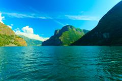 Stock Photo of tourism and travel. mountains and fjord in norway.