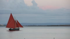 Boat with red Sail Stock Footage