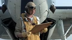 Grumman Avenger and pilot with flight plan 4K Stock Footage