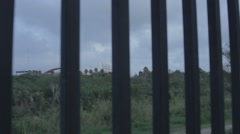 Border Wall in Texas with Mexico in the background Stock Footage